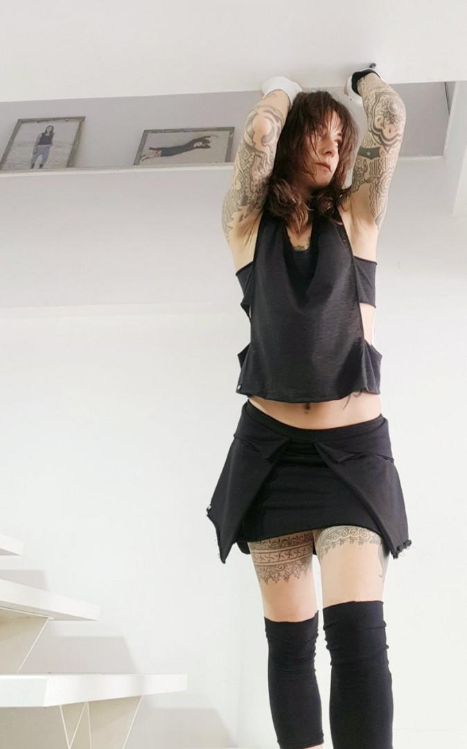 Edgy sleeveless top black Small/Medium