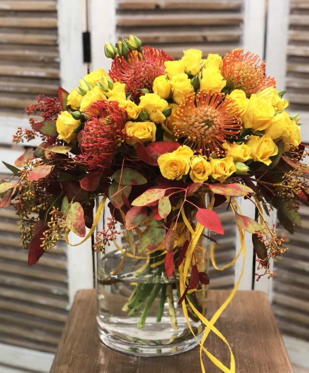 Bouquet of Yellow Mini Roses, with Leucospermum, and Colored Eucalyptus. Includes the Vase