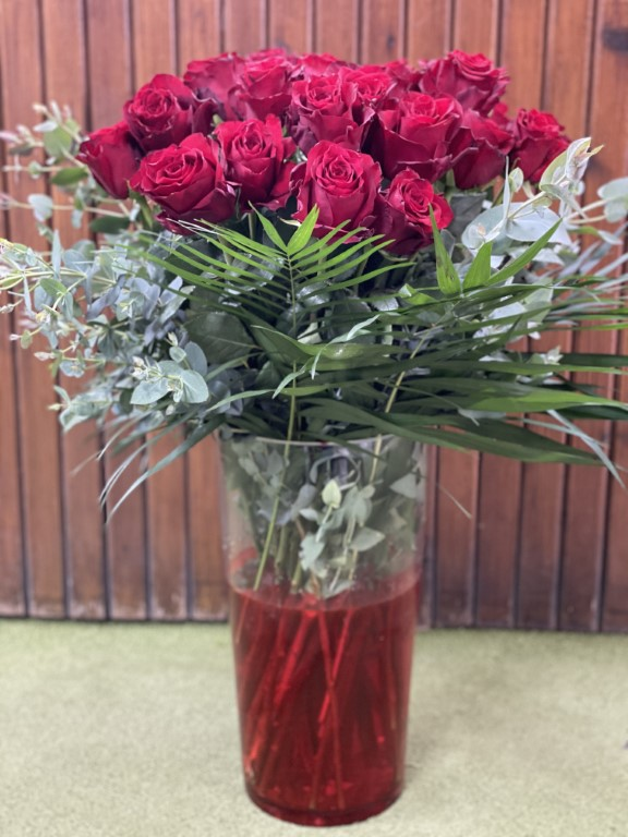 Red Roses with Greens in a Large Glass Vase