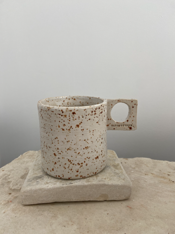 ceramic mug with square holder. Color in white.