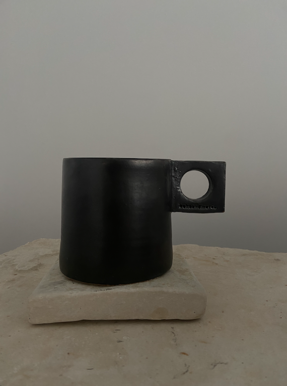 ceramic mug with square holder. Color is Black.