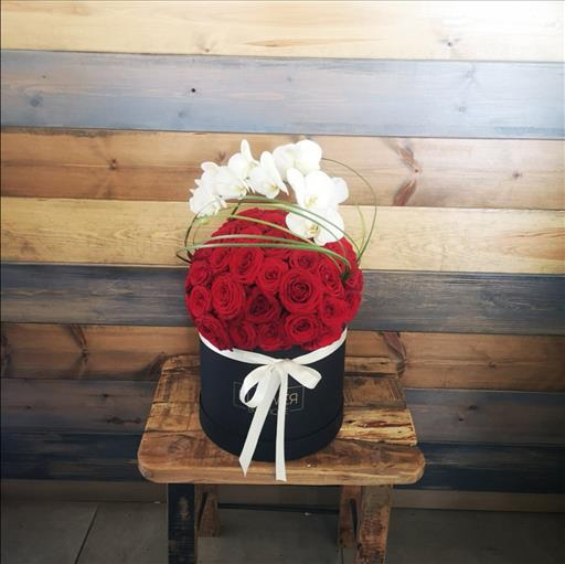 PHALEONOPSIS AND ROSES IN A BOX
