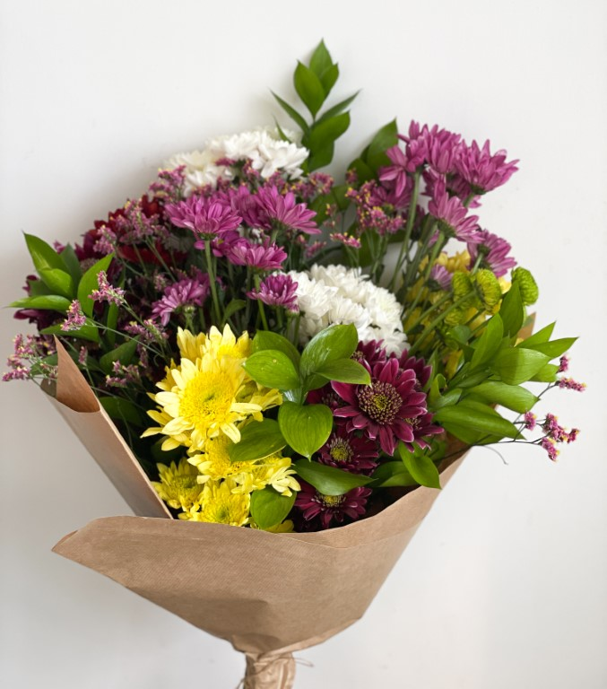 Bouquet with multicoloured chrysanthemum and greenery