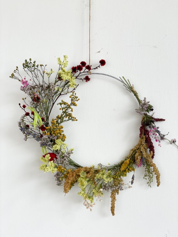 Hanging flower wreath with dried flowers - colourful