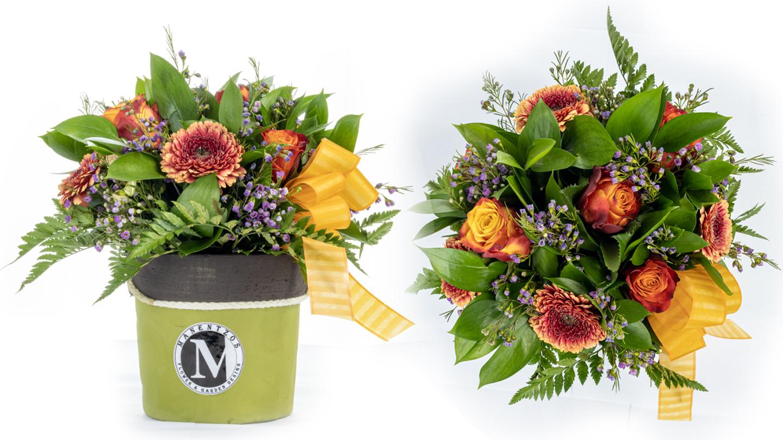 Mixed orange flowers in green pot