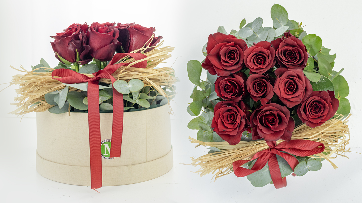 Box with red roses and eucalyptus